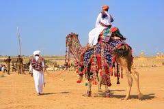 Local man riding a camel at Desert Festival, Jaisalmer, India Stock Photos