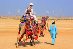 Local man riding a camel at Desert Festival, Jaisalmer, India Stock Images