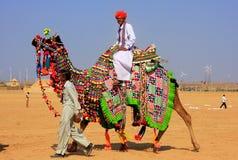 Local man riding a camel at Desert Festival, Jaisalmer, India Royalty Free Stock Photo