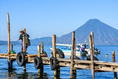 Local man & San Pedro volcano, Lake Atitlan, Guatemala Stock Photos