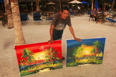Local man selling paintings at Boca Chica beach Royalty Free Stock Images