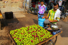 Local man selling water chestnuts singhara at the street marke. T in Fatehpur Sikri, Uttar Pradesh, India. The city was founded in 1569 by the Mughal Emperor stock photo