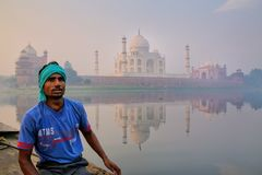 Local man sitting in a boat on Yamuna River near Taj Mahal in ea