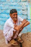 Local man sitting by the house in Fatehpur Sikri, Uttar Pradesh,. India. The city was founded in 1569 by the Mughal Emperor Akbar, and served as the capital of Stock Image