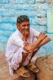 Local man sitting by the house in Fatehpur Sikri, Uttar Pradesh, Stock Image