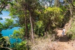 A local man walking by Chala Lake on the border of Kenya and Tan Royalty Free Stock Image