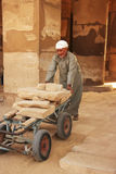 Local man working at Karnak temple complex, Luxor Royalty Free Stock Photo