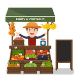 Local market farmer selling vegetables produce. Stock Images