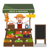 Local market farmer selling vegetables produce. Royalty Free Stock Photos