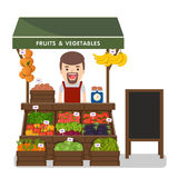 Local market farmer selling vegetables produce. Royalty Free Stock Photography