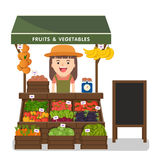 Local market farmer selling vegetables produce. Royalty Free Stock Images