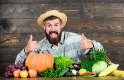 Local market. Homegrown vegetables. Buy vegetables local farm. Farm market harvest festival. Sell vegetables. Man. Bearded farmer with vegetables rustic style stock photo