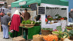 Local open-air market. Local shop in an open air market in Totnes UK Stock Photography