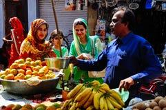 The local market in Udaipur, India. Locals shopping at the local market in Udaipur, India stock photography