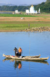 Local men in a boat near U Bein Bridge, Amarapura, Myanmar Royalty Free Stock Photo