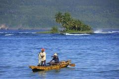 Local men fishing near Las Galeras, Samana peninsula Stock Photos