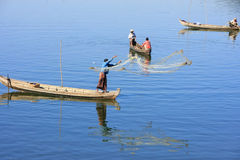 Local men fishing with a net from a boat, Amarapura, Myanmar Royalty Free Stock Photography