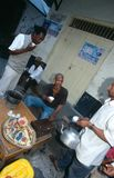 Local men hanging out at street side stall, Zanzibar Stock Images