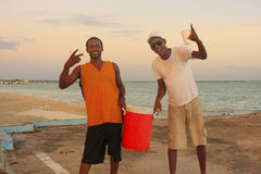 Local men having party at Boca Chica beach Royalty Free Stock Image
