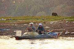 Local men paddling boat on the Nile river, Luxor Royalty Free Stock Photos