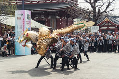 Local men performing the Golden Dragon Dance `Kinryu no mai` Royalty Free Stock Image