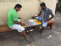 Local men play checkers on street Royalty Free Stock Images