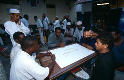 Local men playing a board game in Zanzibar Royalty Free Stock Photos