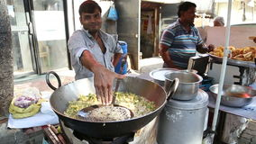 Local men preparing and selling food on the streets of Mumbai. stock video footage