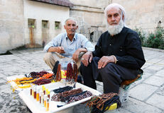 Local men selling beads and perfume at the entrance to Abrahams Pool in Urfa in Turkey. Stock Photos