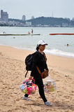 Local merchant selling souvenirs to tourists at Pattaya beach Stock Image