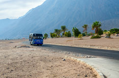 Local minibus on the road in the resort area of Egypt Stock Photo