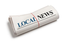 Local News. Newspaper roll with white background royalty free stock photography