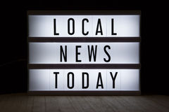Local news today. `Local news today` text in lightbox royalty free stock photography