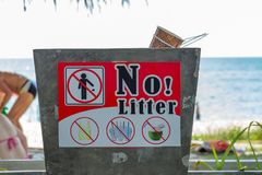 Local no littering signboard on a beach,Clean beach. Local no littering signboard on a beach,Clean beach Royalty Free Stock Photo