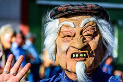 Local with old Chinese man mask, Cuidad Vieja, Guatemala Royalty Free Stock Images