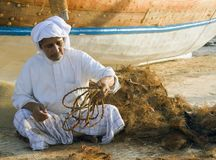 Local old man making ropes in a traditional way royalty free stock photo