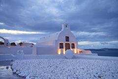 A local orthodox chapel in Oia, Santorini island, Greece, at nig Stock Image