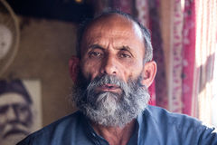 A local pakistani old guy posing bored Royalty Free Stock Photo