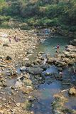 Local people bathing and washing clothes in Nepal Stock Photography