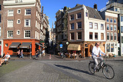 Local people on bicycle in historical center in Amsterdam, the N Stock Image