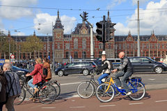 Local people on bicycles cross the road in front of Central Stat Royalty Free Stock Image