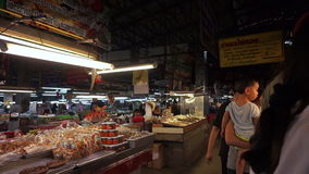 Local people buying cooked food, fresh fruit and vegetables at a fresh market in south east asia. stock video