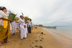 Local people during ceremony Melasti Ritual. Royalty Free Stock Photography