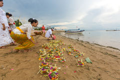 Local people during ceremony Melasti Ritual. Royalty Free Stock Images