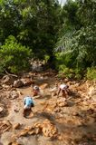Local people do gold or tin panning in a river in Thailand royalty free stock photos