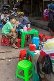 Local people eating street foods in Yangon, Myanmar. Stock Photo