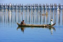 Local people fishing from a boat near U Bein Bridge, Amarapura,. Mandalay region, Myanmar Stock Photography