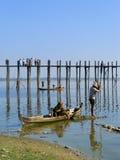 Local people fishing from a boat near U Bein Bridge, Amarapura,. Mandalay region, Myanmar Royalty Free Stock Images