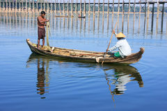 Local people fishing from a boat near U Bein Bridge, Amarapura, Stock Photos