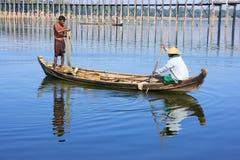 Local people fishing from a boat near U Bein Bridge, Amarapura,. Mandalay region, Myanmar Stock Photos